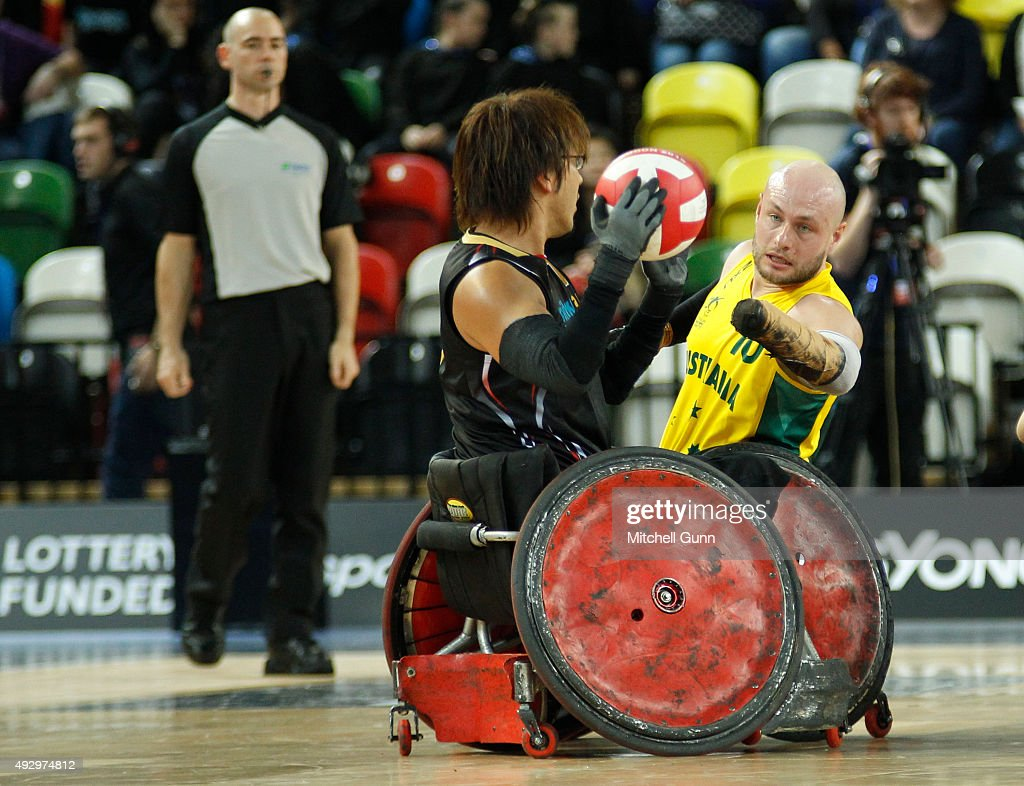 Daisuke Ikezaki of Japan competes against Chris Bond of Australia during the 2015 BT World Wheelchair Rugby Challenge bronze medal playoff match between Australia and Japan at The Copper Box on October 16, 2015 in London, United Kingdom.