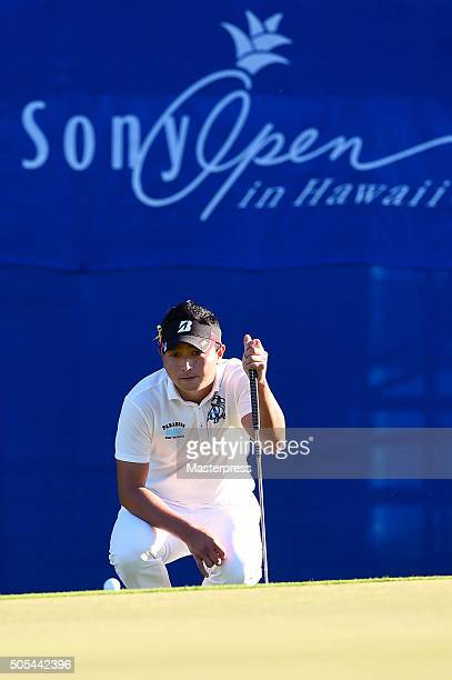 Daisuke Kataoka of Japan lines up on the 18th green during the final round of the Sony Open In Hawaii at Waialae Country Club on January 17 2016 in...