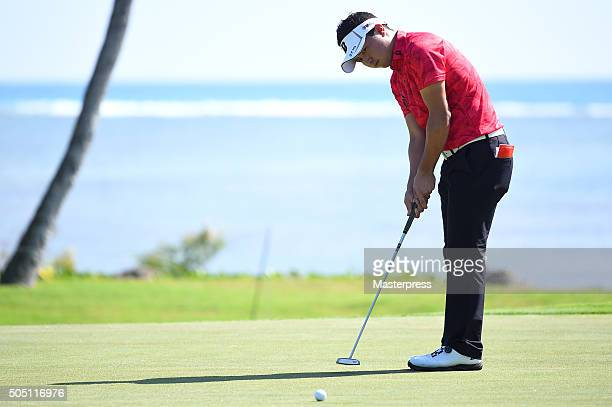 Daisuke Kataoka of Japan putts on the 17th green during the first round of the Sony Open In Hawaii at Waialae Country Club on January 14 2016 in...