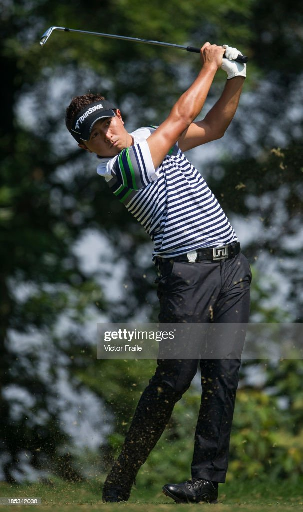 <a gi-track='captionPersonalityLinkClicked' href=/galleries/search?phrase=Daisuke+Kataoka&family=editorial&specificpeople=8204705 ng-click='$event.stopPropagation()'>Daisuke Kataoka</a> of Japan tees off on the 6ht hole during day three of the Venetian Macau Open at Macau Golf and Country Club on October 19, 2013 in Macau, Macau.