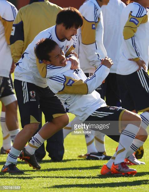 Daisuke Matsui wrestles with Yuto Nagatomo at a Japan training session during the FIFA 2010 World Cup at Outeniqua Stadium on June 17 2010 in George...