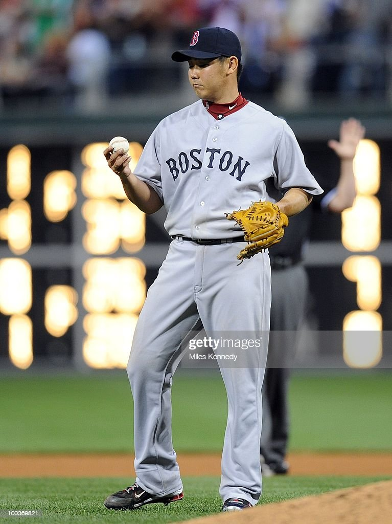 Daisuke Matsuzaka #18 of the Boston Red Sox looks at the ball after giving up a hit against the Philadelphia Phillies in the eighth inning on May 22, 2010 at Citizens Bank Park in Philadelphia, Pennsylvania. The Red Sox won 5-0.