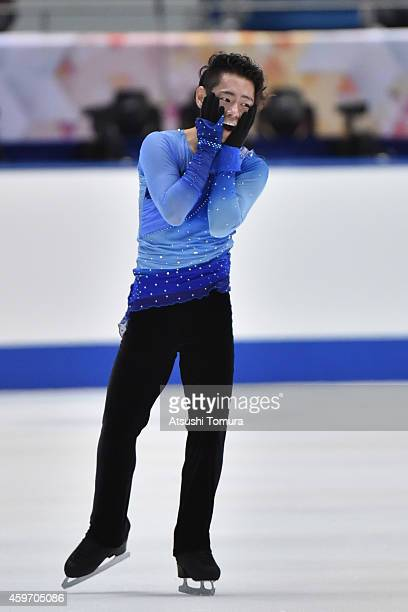 Daisuke Murakami of Japan celebrates after the Men Free Skating during day two of ISU Grand Prix of Figure Skating 2014/2015 NHK Trophy at the...