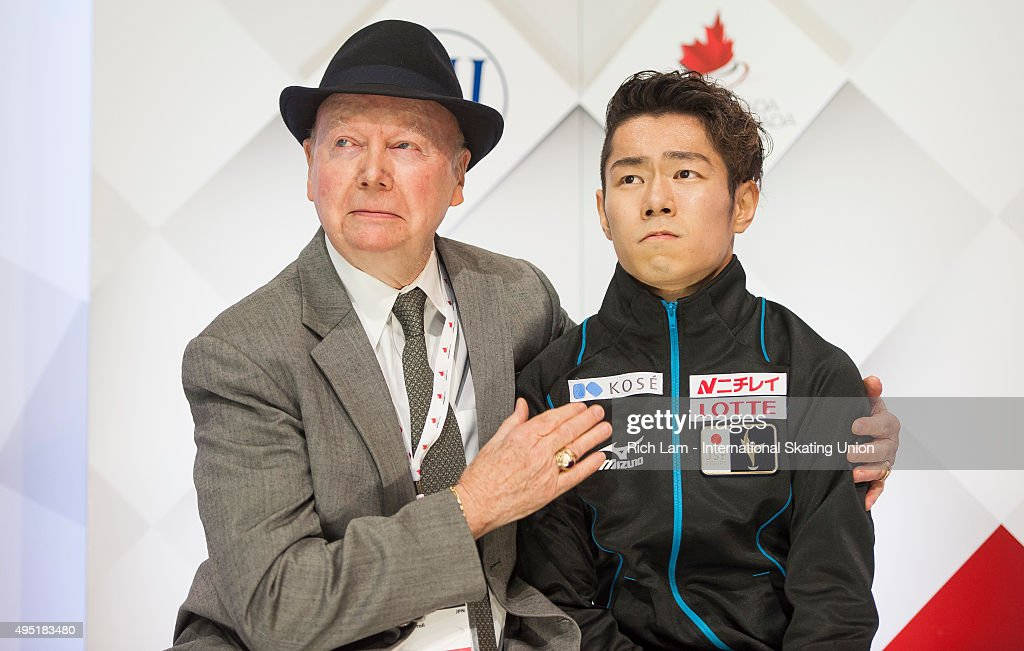 Daisuke Murakami of Japan is hugged by his coach Frank Carroll after seeing his score in the Men Free Skate on day two of Skate Canada International ISU Grand Prix of Figure Skating, October, 31, 2015 at ENMAX Centre in Lethbridge, Alberta, Canada.