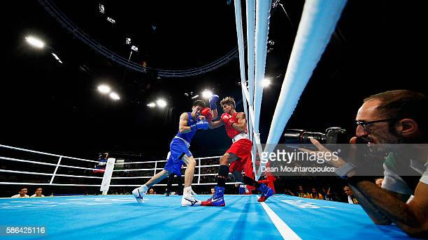 Daisuke Narimatsu of Japan lands a blow on Luis Cabrera of Venezuela in their Men's Light 60kg Preliminaries bout on Day 1 of the Rio 2016 Olympic...