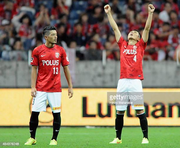 Daisuke Nasu and Keita Suzuki of Urawa Red Diamonds celebrate their 40 win after the JLeague match between Urawa Red Diamonds and Omiya Ardija at...