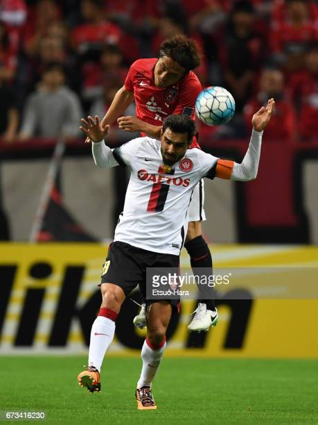 Daisuke Nasu of Urawa Red Diamonds and Dimas Delgado of Western Sydney compete for the ball during the AFC Champions League Group F match between...
