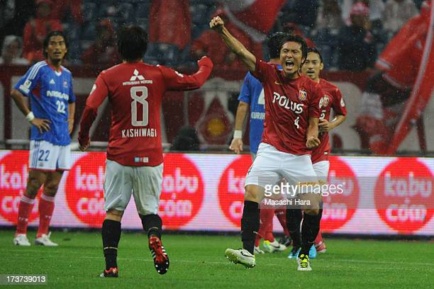 Daisuke Nasu of Urawa Red Diamonds celebrates the first goal during the JLeague match between Urawa Red Diamonds and Yokohama FMarinos at Saitama...