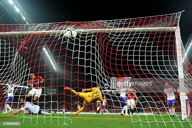 Daisuke Nasu of Urawa Reds scores his team's fifth goal past goalkeeper Tatsuya Morita of Albirex Niigata during the JLeague match between Urawa Red...