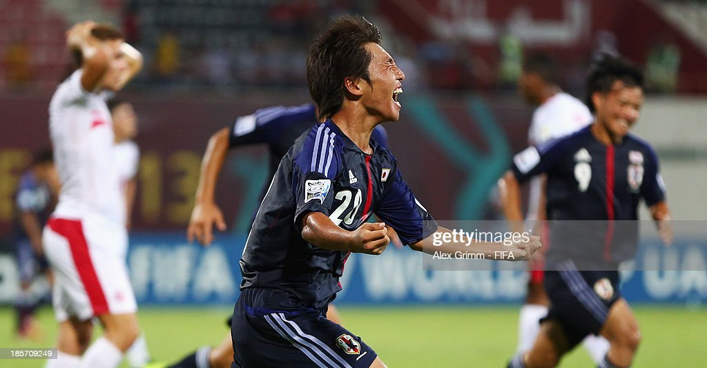 Daisuke Sakai of Japan celebrates his team's first goal during the FIFA U-17 World Cup UAE 2013 Group D match between Japan and Tunisia at Sharjah Stadium on October 24, 2013 in Sharjah, United Arab Emirates.