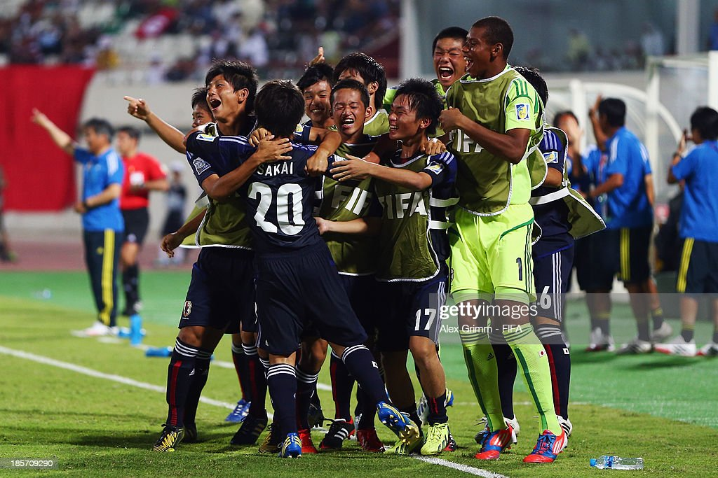 Daisuke Sakai (C) of Japan celebrates his team's first goal with team mates during the FIFA U-17 World Cup UAE 2013 Group D match between Japan and Tunisia at Sharjah Stadium on October 24, 2013 in Sharjah, United Arab Emirates.