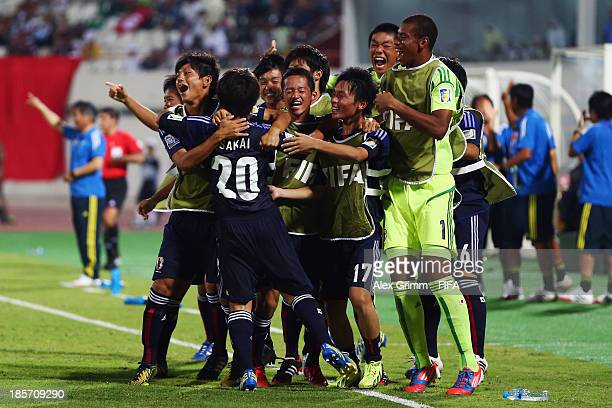 Daisuke Sakai of Japan celebrates his team's first goal with team mates during the FIFA U17 World Cup UAE 2013 Group D match between Japan and...