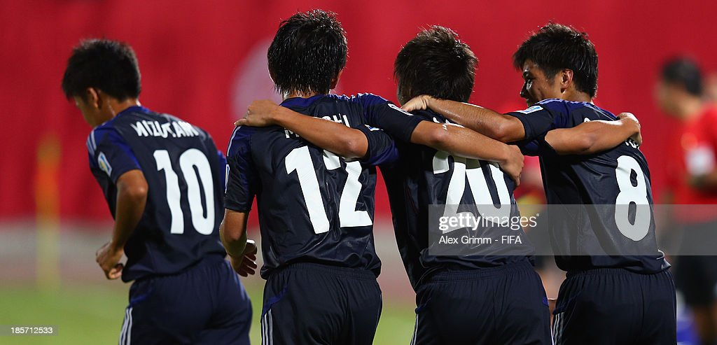 Daisuke Sakai (2R) of Japan celebrates his team's first goal with team mates Takuma Mizutani, Koji Miyoshi and Taro Sugimoto (L-R) during the FIFA U-17 World Cup UAE 2013 Group D match between Japan and Tunisia at Sharjah Stadium on October 24, 2013 in Sharjah, United Arab Emirates.