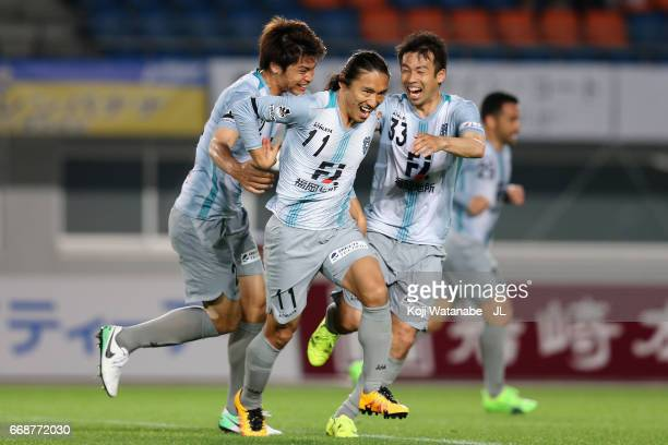 Daisuke Sakata of Avispa Fukuoka celebrates scoring the opening goal with his team mates Mizuki Hamada and Koji Yamase during the JLeague J2 match...