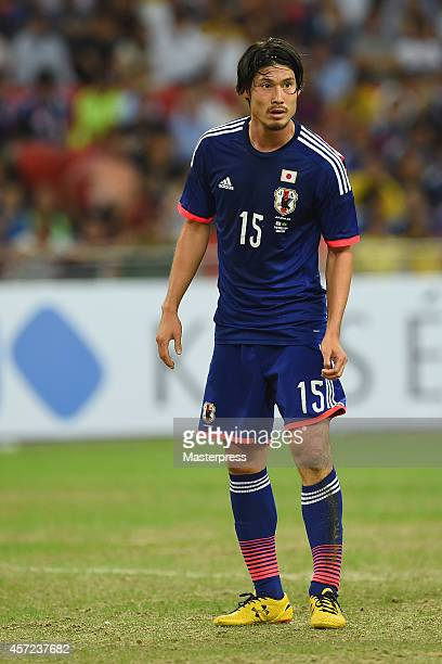 Daisuke Suzuki of Japan in action during the international friendly match between Japan and Brazil at the National Stadium on October 14 2014 in...