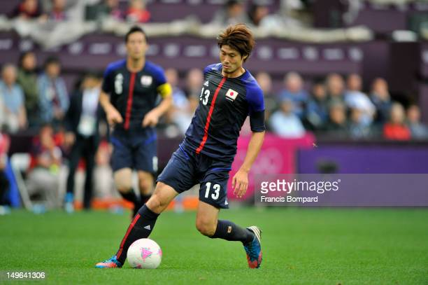 Daisuke Suzuki of Japan kick the the ball during the Men's Football first round Group D Match between Japan and Honduras on Day 5 of the London 2012...