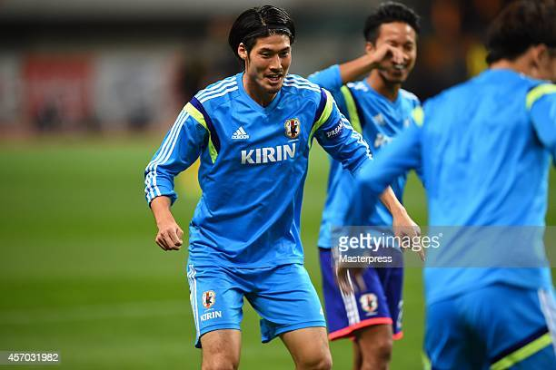 Daisuke Suzuki of Japan practises before the international friendly match between Japan and Jamaica at Denka Big Swan Stadium on October 10 2014 in...