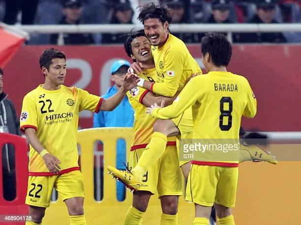 Daisuke Suzuki of Japan's Kashiwa Reysol celebrates with his teammates after scoring a goal against China's Shandong Luneng FC during their AFC...