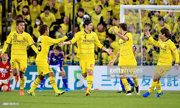 Daisuke Suzuki of Kashiwa Reysol celebrates scoring his team's first goal with his team mates during the J League match between Kashiwa Reysol and...