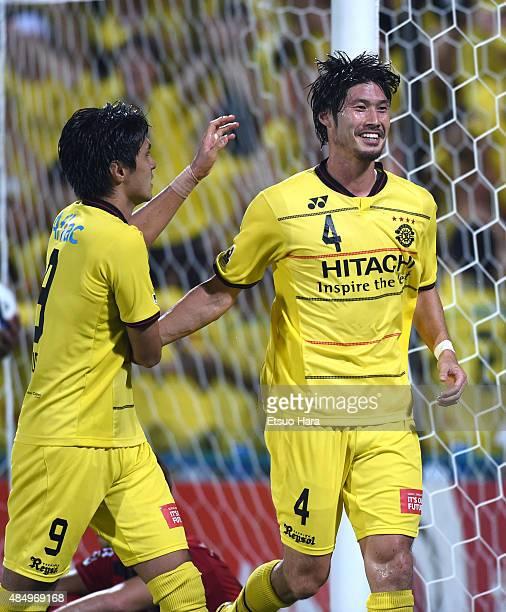 Daisuke Suzuki of Kashiwa Reysol celebrates scoring his team's second goal with his team mate Masato Kudo during the JLeague match between Kashiwa...