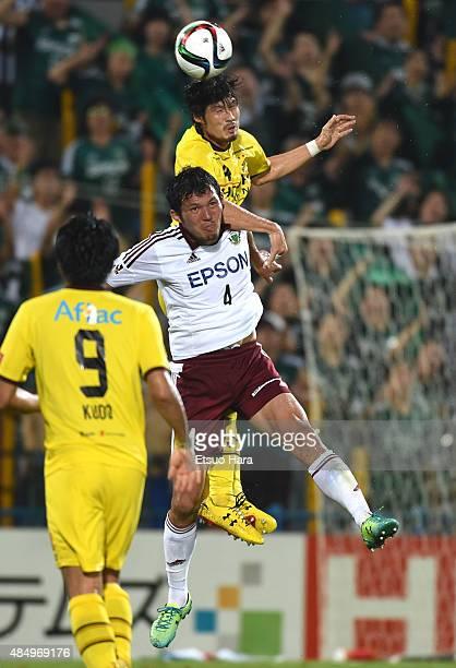 Daisuke Suzuki of Kashiwa Reysol outjumps Masaki Iida of Matsumoto Yamaga during the JLeague match between Kashiwa Reysol and Matsumoto Yamaga at...