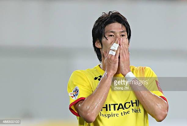Daisuke Suzuki of Kashiwa Reysol reacts during the Asian Champions League Quarter Final match between Guangzhou Evergrande and Kashiwa Reysol at...