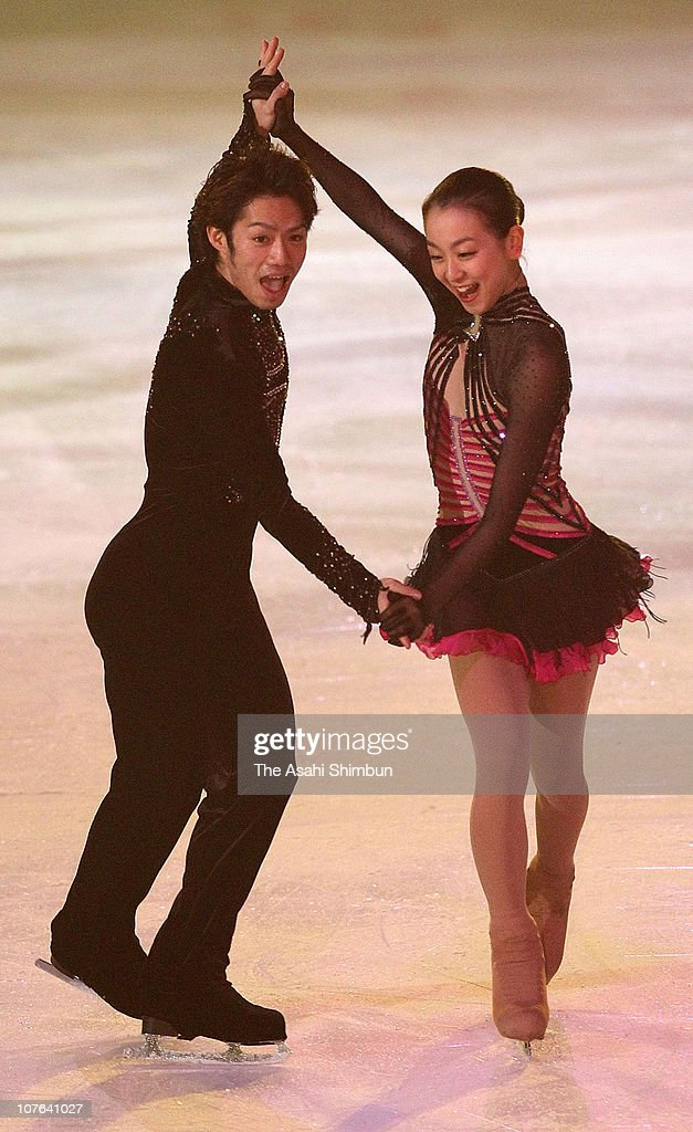<a gi-track='captionPersonalityLinkClicked' href=/galleries/search?phrase=Daisuke+Takahashi&family=editorial&specificpeople=725172 ng-click='$event.stopPropagation()'>Daisuke Takahashi</a> and <a gi-track='captionPersonalityLinkClicked' href=/galleries/search?phrase=Mao+Asada&family=editorial&specificpeople=247229 ng-click='$event.stopPropagation()'>Mao Asada</a> perform in the exhibition during the All Japan Figure Skating Championship at Namihaya Dome on December 28, 2009 in Kadoma, Osaka, Japan.