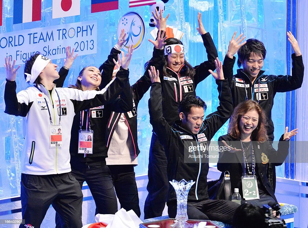 Daisuke Takahashi of Japan celebrates with team-mates in the free program during day two of the ISU World Team Trophy at Yoyogi National Gymnasium on April 12, 2013 in Tokyo, Japan.