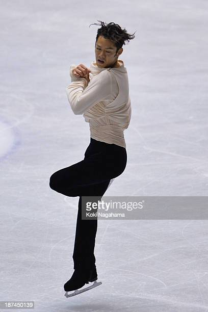Daisuke Takahashi of Japan competes in the men's free program during day two of ISU Grand Prix of Figure Skating 2013/2014 NHK Trophy at Yoyogi...