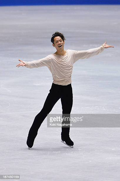 Daisuke Takahashi of Japan competes in the men's free program during day two of ISU Grand Prix of Figure Skating 2013/2014 NHK Trophy at Yoyogi...