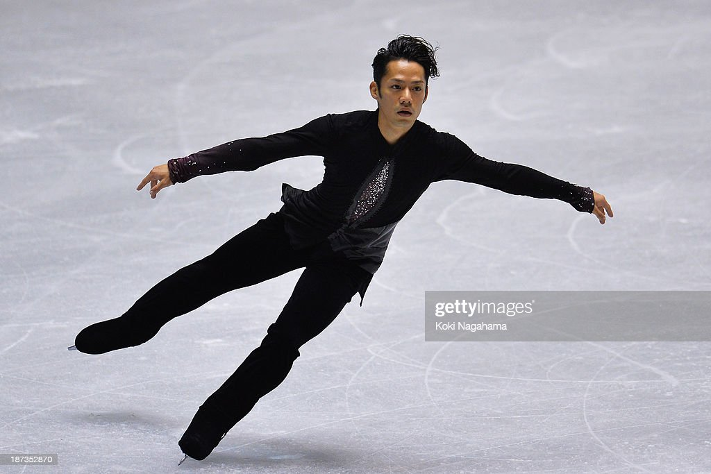 Daisuke Takahashi of Japan competes in the men's short program during day one of ISU Grand Prix of Figure Skating 2013/2014 NHK Trophy at Yoyogi...