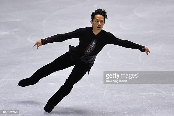 Daisuke Takahashi of Japan competes in the men's short program during day one of ISU Grand Prix of Figure Skating 2013/2014 NHK Trophy at Yoyogi...