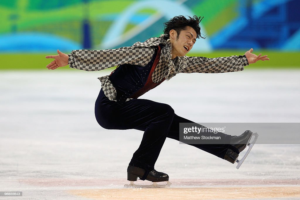 Daisuke Takahashi of Japan ompetes in the men's figure skating free skating on day 7 of the Vancouver 2010 Winter Olympics at the Pacific Coliseum on...