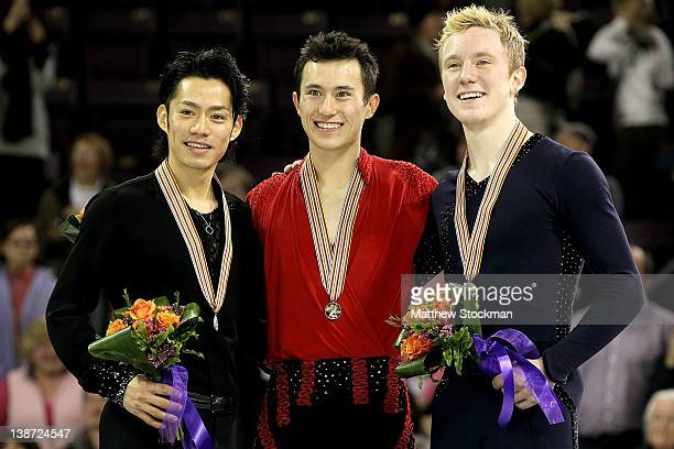 Daisuke Takahashi of Japan Patrick Chan of Canada and Ross Miner pose on the victory podium after the Men's Competition during the ISU Four...
