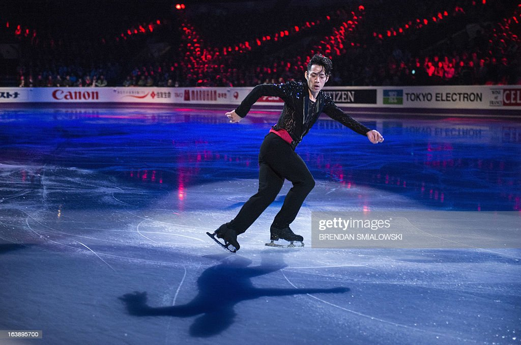 Daisuke Takahashi of Japan performs during the exhibition program at the 2013 World Figure Skating Championships on March 17, 2013 in London, Ontario. Gold, silver and bronze medalists of the championships as well as invited skaters performed in the post-competition exhibition. AFP PHOTO/Brendan SMIALOWSKI