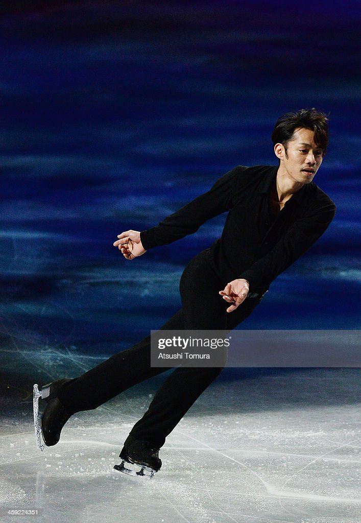 Daisuke Takahashi of Japan performs his routine in the Gala exhibition during All Japan Figure Skating Championships at Saitama Super Arena on December 24, 2013 in Saitama, Japan.