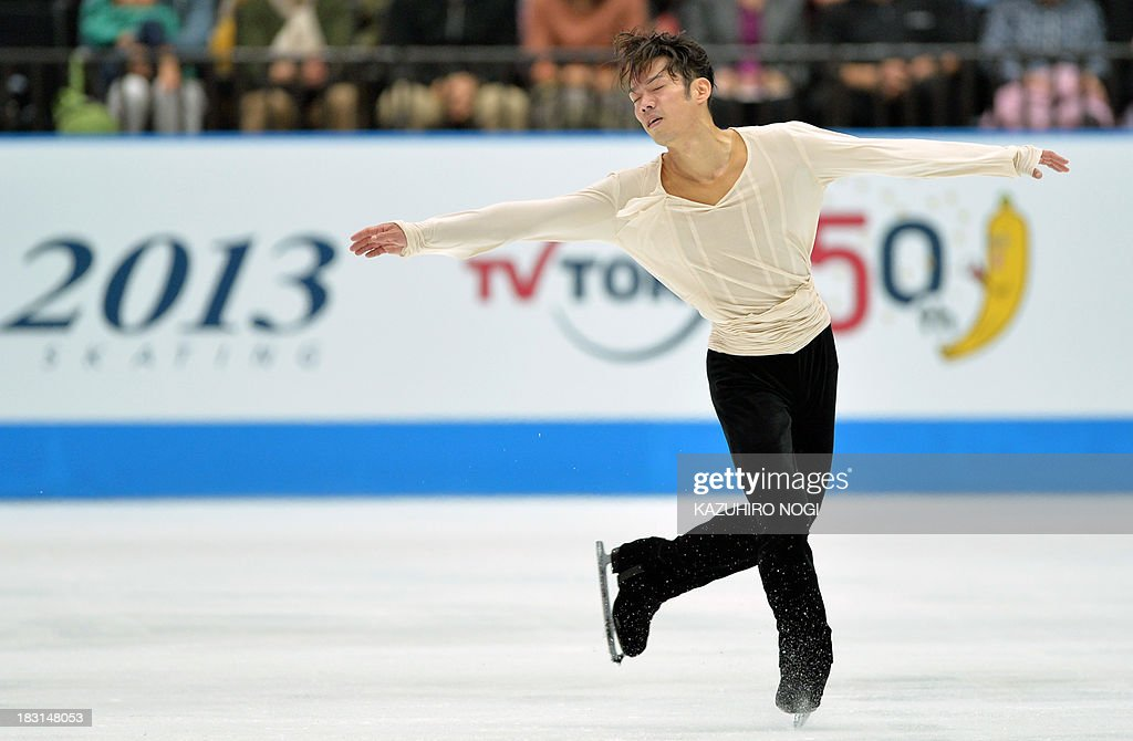 Daisuke Takahashi of Japan performs in the men's free skating at the Japan Open figure skating competition at Saitama Super Arena in Saitama on October 5, 2013. Takahashi scored with a 149.12 points and his team Japan won the competition with a total 544.85 points.