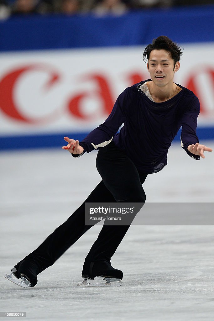 Daisuke Takahashi of Japan performs in the men's free skating during All Japan Figure Skating Championships at Saitama Super Arena on December 22, 2013 in Saitama, Japan.