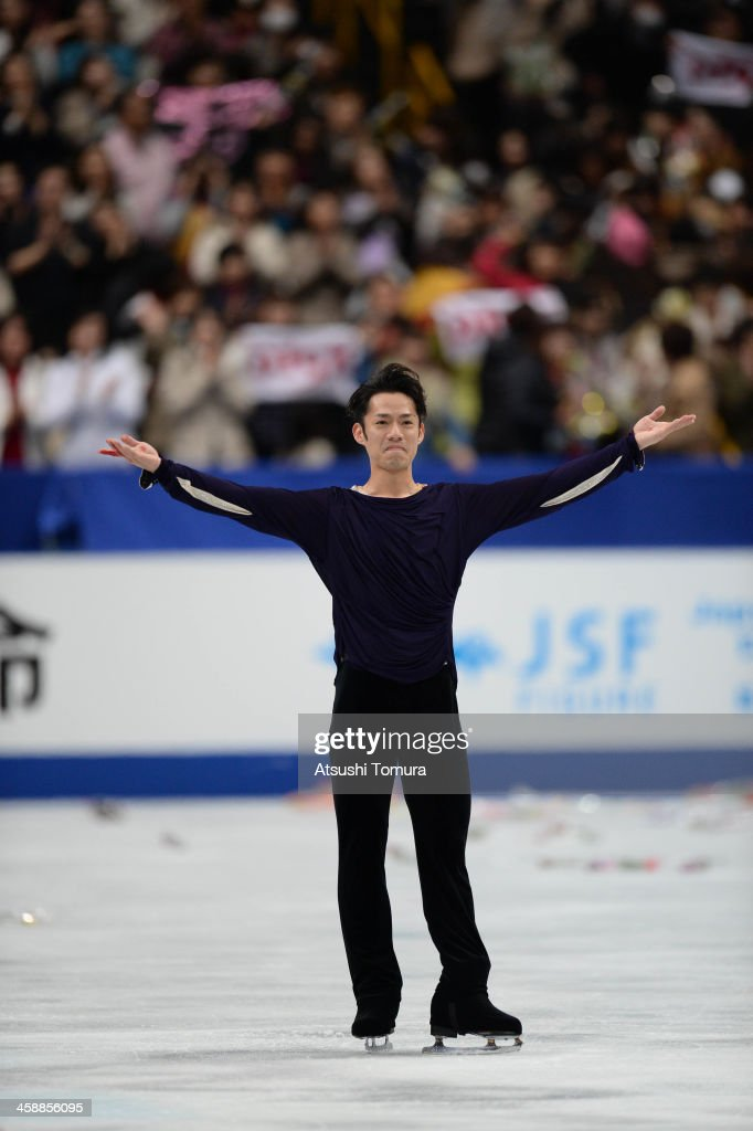 Daisuke Takahashi of Japan performs in the men's free skating during All Japan Figure Skating Championships at Saitama Super Arena on December 22, 2013 in Saitama, Japan.