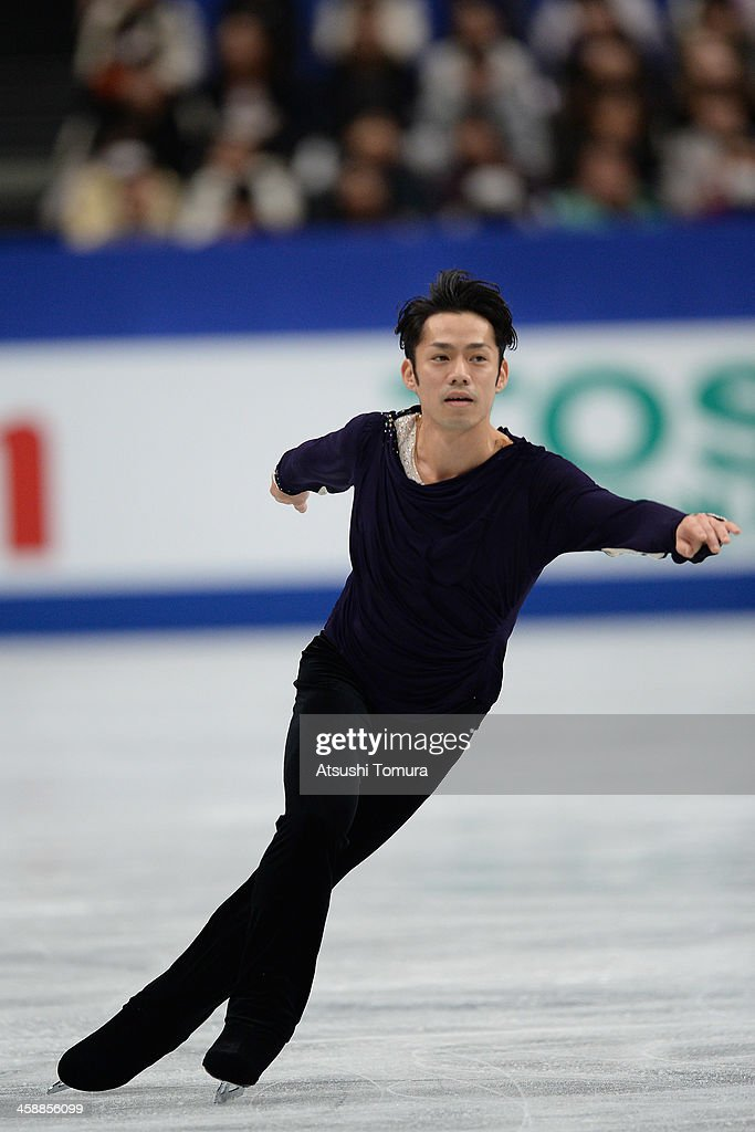 <a gi-track='captionPersonalityLinkClicked' href=/galleries/search?phrase=Daisuke+Takahashi&family=editorial&specificpeople=725172 ng-click='$event.stopPropagation()'>Daisuke Takahashi</a> of Japan performs in the men's free skating during All Japan Figure Skating Championships at Saitama Super Arena on December 22, 2013 in Saitama, Japan.