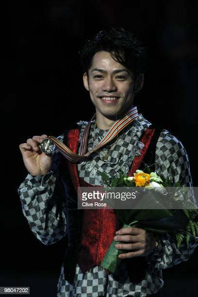 Daisuke Takahashi of Japan poses with his Gold medal after the Men's Free Skate during the 2010 ISU World Figure Skating Championships on March 25...