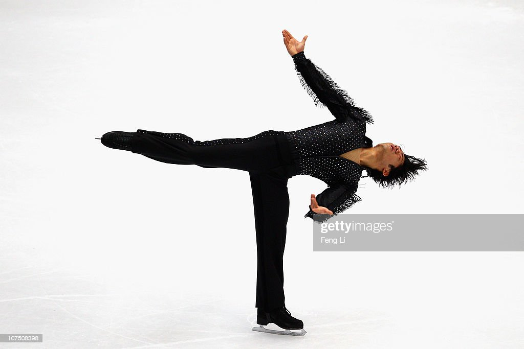 Daisuke Takahashi of Japan skates in the Men Short Program during ISU Grand Prix and Junior Grand Prix Final at Beijing Capital Gymnasium on December...