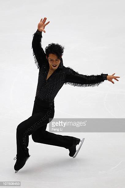 Daisuke Takahashi of Japan skates in the Men Short Program during ISU Grand Prix and Junior Grand Prix Final at Beijing Capital Gymnasium on December...