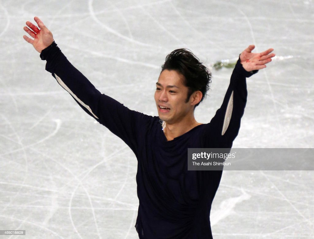 Daisuke Takahashi reacts after competing in the Men's Singles Free Program during the 82nd All Japan Figure Skating Championships at Saitama Super Arena on December 22, 2013 in Saitama, Japan.