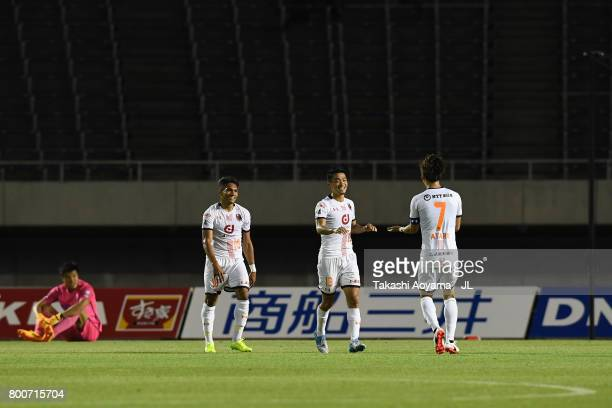 Daisuke Watabe of Omiya Ardija celebrates scoring his side's third goal with his team mates Ataru Esaka and Mateus during the JLeague J1 match...