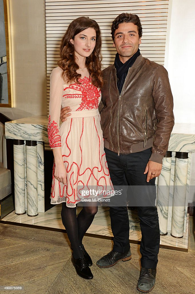 Daisy Bevan and Oscar Isaac pose at a photocall for 'The Two Faces Of January' at Corinthia Hotel London on May 13 2014 in London England