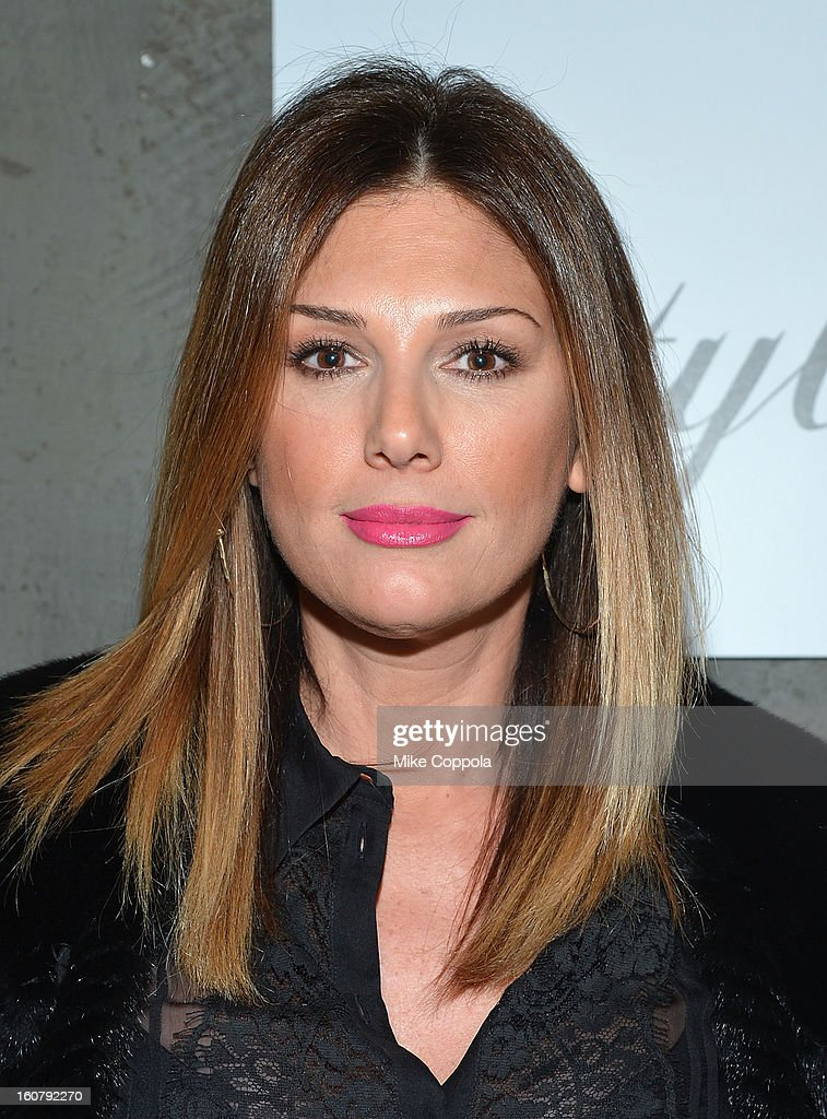 Daisy Fuentes poses for a picture as she Celebrates The New JohnVarvatos.com on February 5, 2013 in New York City.