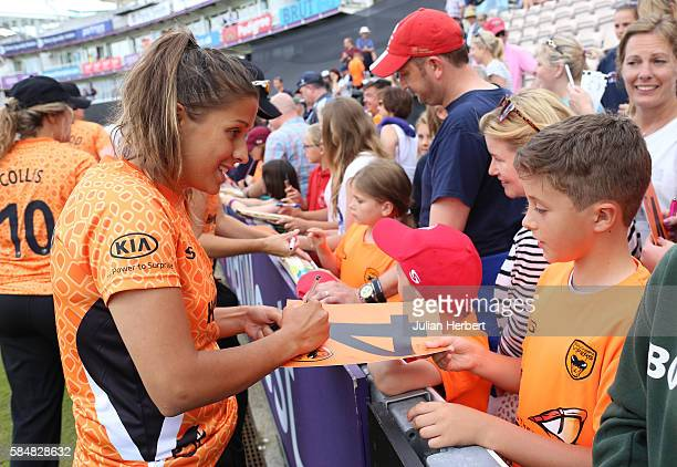 Daisy Gardner of the Southern Vipers signs autographs after the Kia Super League women's cricket match between the Southern Vipers and the Surrey...
