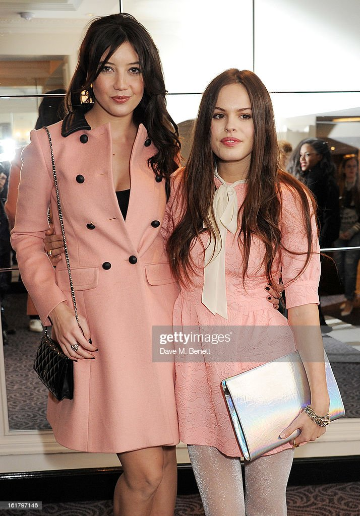 Daisy Lowe (L) and Atlanta de Cadenet attend the Moschino cheap&chic show during London Fashion Week Fall/Winter 2013/14 at The Savoy Hotel on February 16, 2013 in London, England.