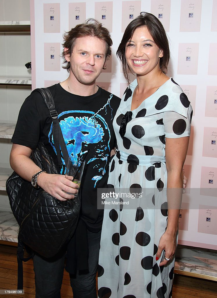 <a gi-track='captionPersonalityLinkClicked' href=/galleries/search?phrase=Daisy+Lowe&family=editorial&specificpeople=787647 ng-click='$event.stopPropagation()'>Daisy Lowe</a> and Christopher Kane attend as Alexa Chung celebrates the launch of her first book 'It' at Liberty on September 4, 2013 in London, England.